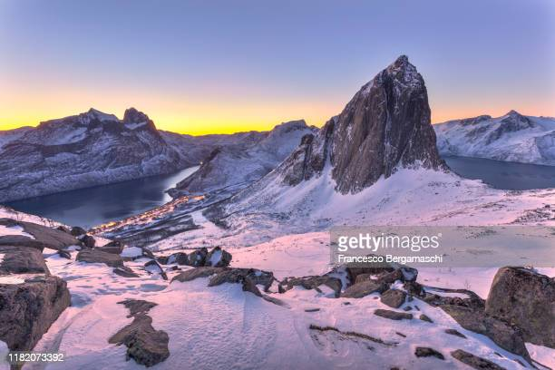sunrise on the amazing peak with view in the fjord. - ノルウェー文化 ストックフォトと画像