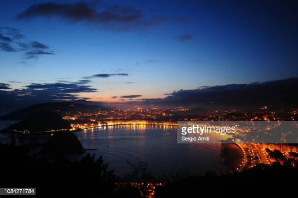 sunrise on the beach of la concha - san sebastian spain stock pictures, royalty-free photos & images