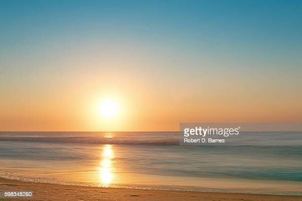 sunrise on the beach - zonsopgang stockfoto's en -beelden