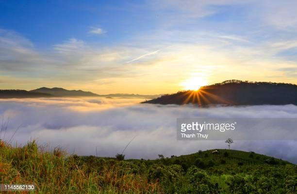 sunrise on the cloudy valley - hochplateau stock-fotos und bilder