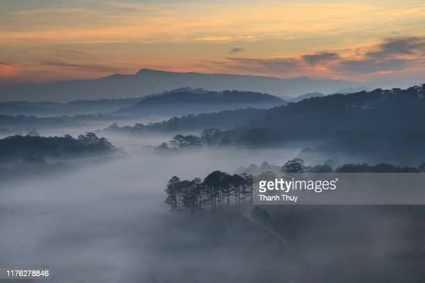 sunrise on the cloudy valley - valley stock pictures, royalty-free photos & images