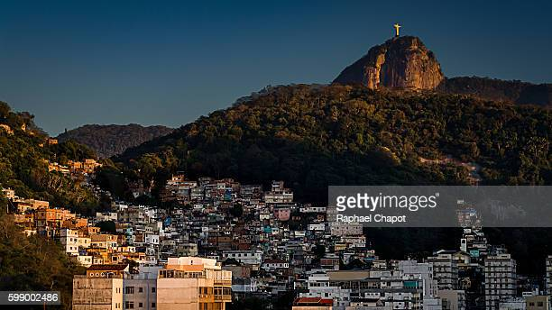Sunrise on the favelas with the christ the redeemer in the background