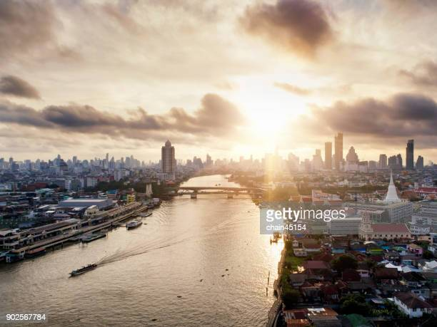Sunrise on the Memorial Bridge from top view over the Chao Phraya River. Bangkok, Thailand. The main river in Bangkok with boat transportation.