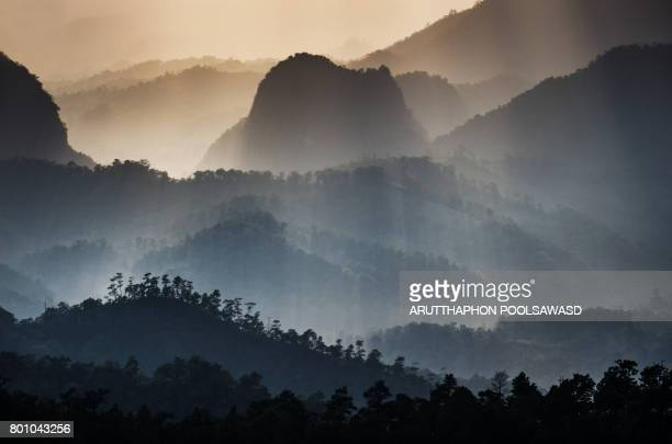Sunrise on the Mountain with moving mist for nature background