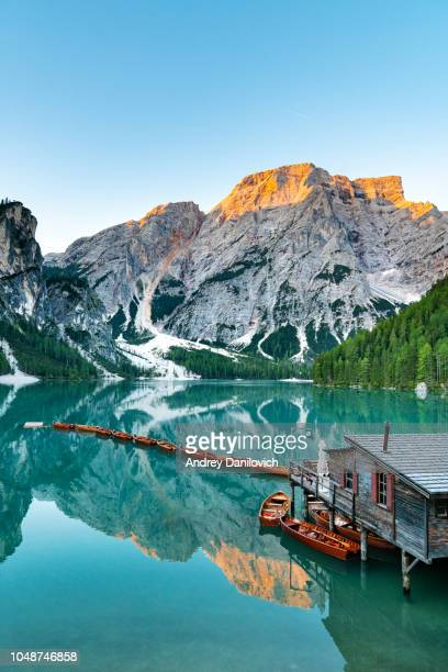 sunrise on the pragser wildsee (lake prags, lake braies, lago di braies) - dolomites stock pictures, royalty-free photos & images