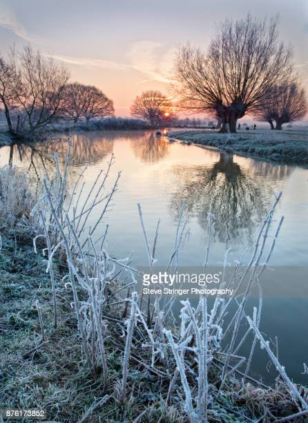 sunrise on the river stour - east anglia stock photos and pictures