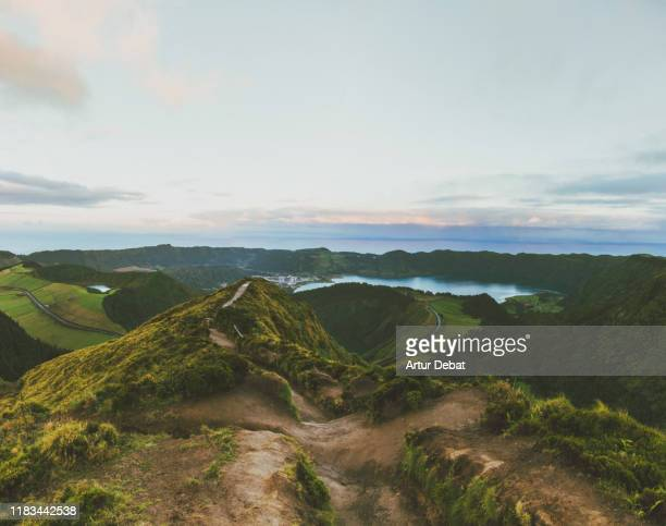 sunrise on top of volcanic crater with lagoon in the azores islands. - paisaje volcánico fotografías e imágenes de stock