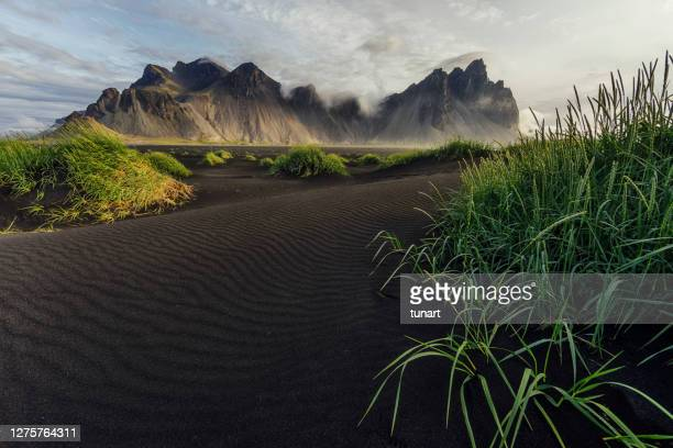 sunrise on vestrahorn mountain, iceland - black sand stock pictures, royalty-free photos & images