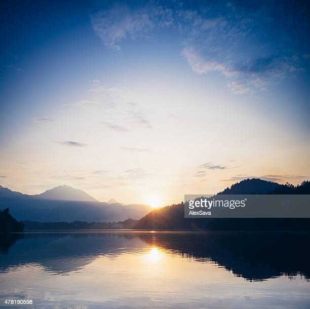 Sunrise over a calm mountain lake