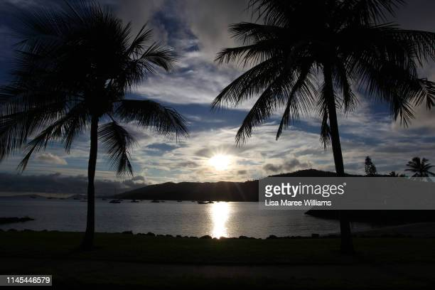 Sunrise over Airlie Bay as seen on April 27 2019 in Airlie Beach Australia The coastal town of Airlie Beach has a population of just over 1200 and is...