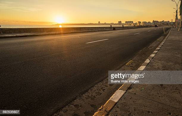 Sunrise over an empty road