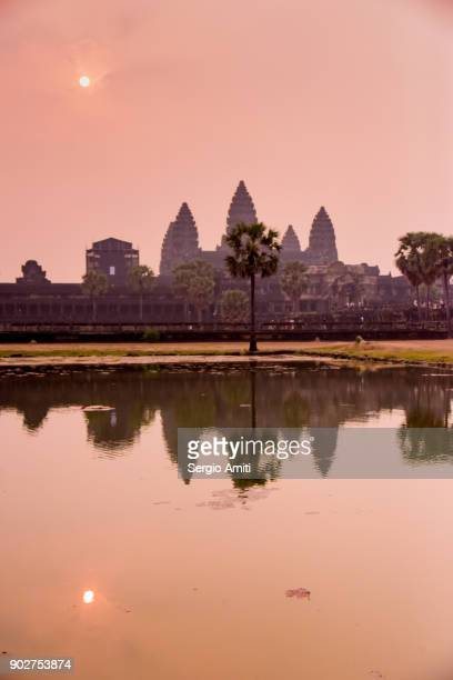 sunrise over angkor wat, cambodia - angkor stock photos and pictures