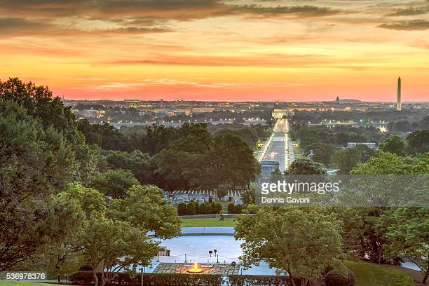 sunrise over arlington national cemetery - eternal flame stock photos and pictures