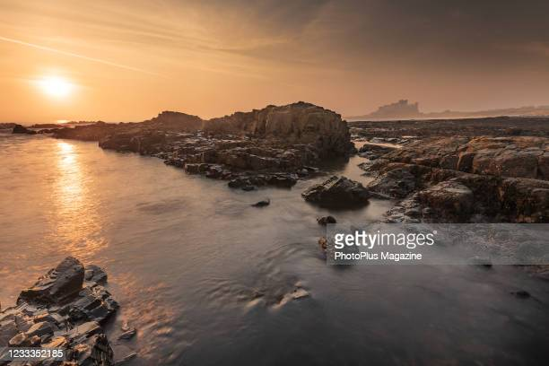 Sunrise over Bamburgh Castle on the Northumberland coastline, taken on April 18, 2019.