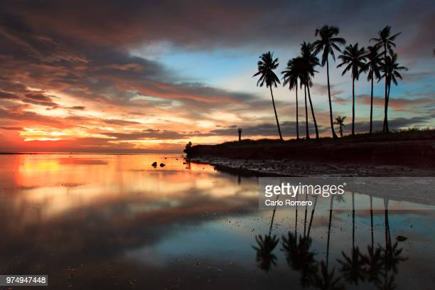 sunrise over beach with palms, cagayan de oro, philippines - mindanao stock pictures, royalty-free photos & images