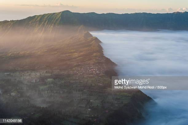 sunrise over bromo village - east java province stock pictures, royalty-free photos & images