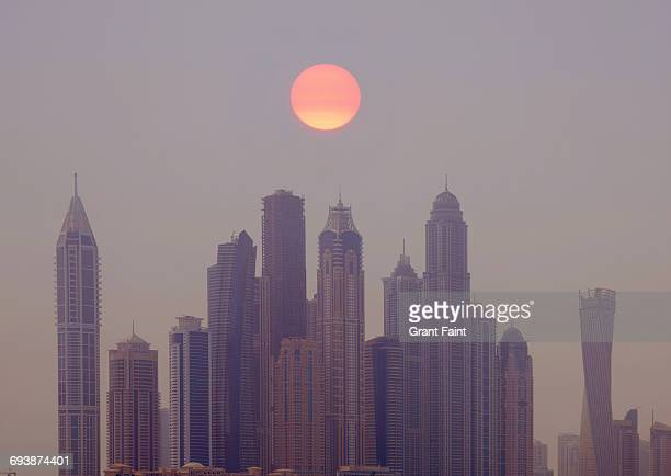 Sunrise over buildings.