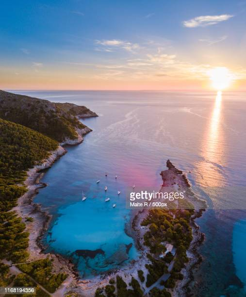 sunrise over cala agulla - majorca stock pictures, royalty-free photos & images