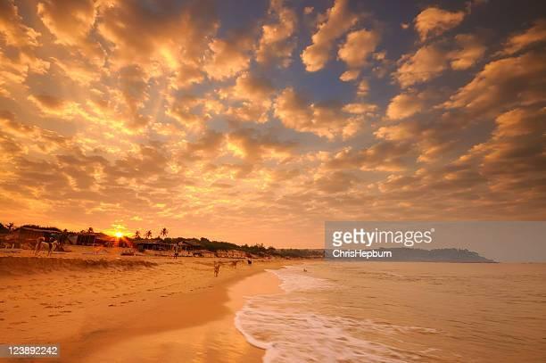 Sunrise over Candolim Beach in Goa, India