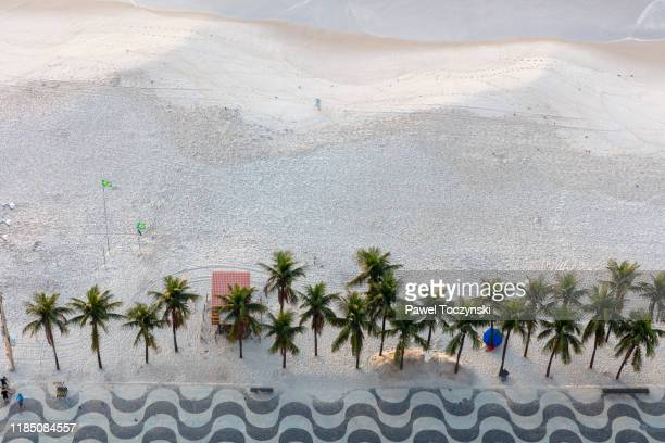 sunrise over copacabana beach, rio de janeiro, brazil - copacabana beach stock pictures, royalty-free photos & images