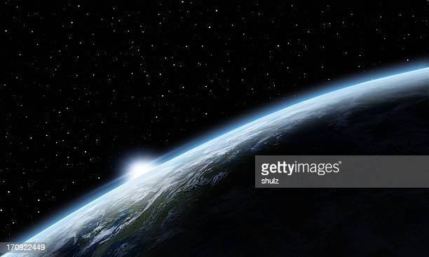 sunrise over earth - planet earth stock pictures, royalty-free photos & images