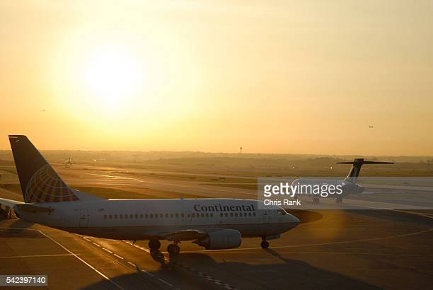 Sunrise over HartsfieldJackson International Airport in Atlanta as a Continental Airlines plane waits for takeoff