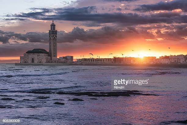 sunrise over hassan ii mosque, casablanca, morocco - mosque hassan ii stock photos and pictures