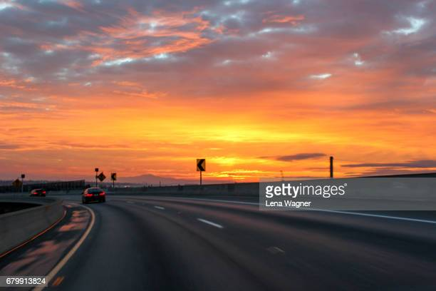 sunrise over highway - redoubtable film stock photos and pictures