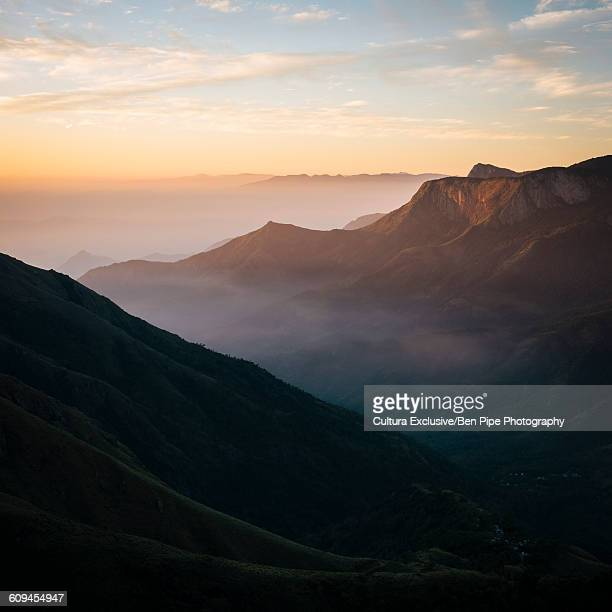 Sunrise over hills and valley, Top Station, Kerala, India