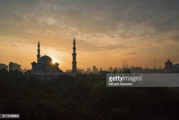 sunrise over kuala lumpur mosque - eid ul fitr stock pictures, royalty-free photos & images