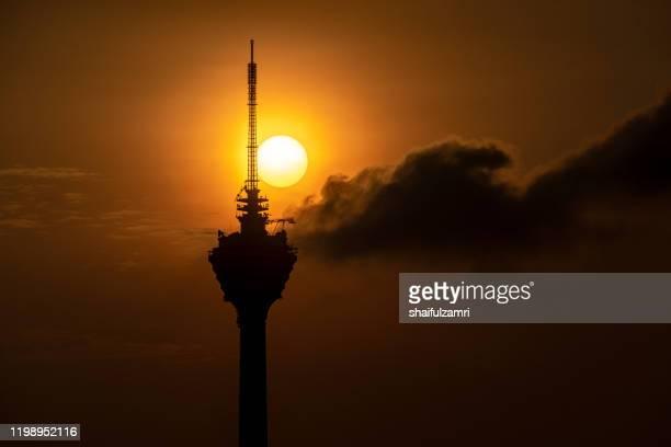 sunrise over kuala lumpur tower, a telecommunications tower with antenna up to 421 metres. - shaifulzamri - fotografias e filmes do acervo