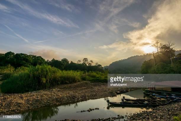 sunrise over kuala tahan jetty - a gateway to taman negara or national park of malaysia. - shaifulzamri fotografías e imágenes de stock