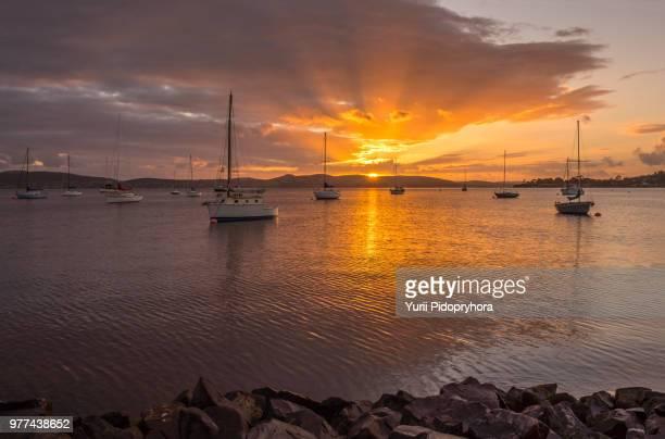 sunrise over lake, hobart, tasmania - hobart tasmania stock photos and pictures
