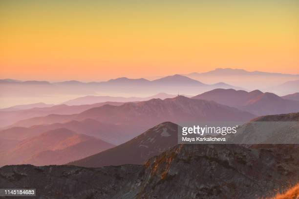 sunrise over layers of mountains - pirin mountains stock pictures, royalty-free photos & images