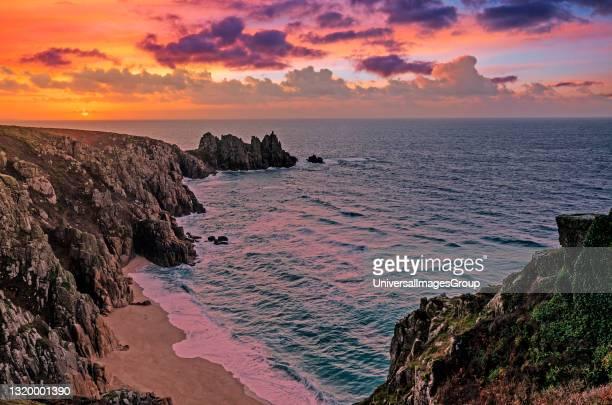 Sunrise over logan rock near pedn vounder beach, treen ,cornwall.
