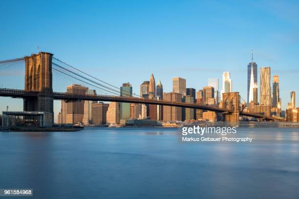 sunrise over manhattan financial district in new york, usa - lower manhattan stock pictures, royalty-free photos & images