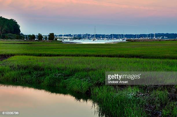 sunrise over marsh meadows, jamestown, rhode isand - newport rhode island stock pictures, royalty-free photos & images