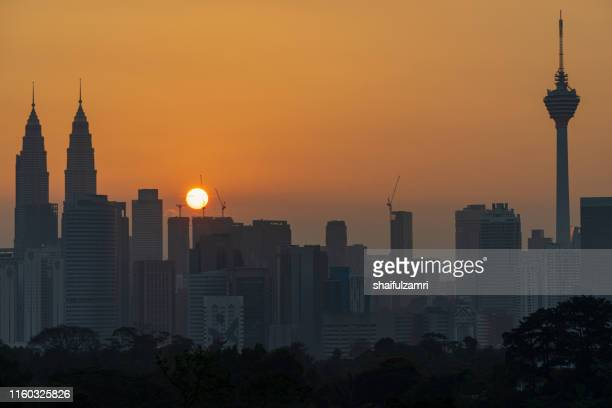 sunrise over modern buildings in midtown of kuala lumpur - shaifulzamri stock pictures, royalty-free photos & images