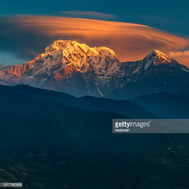 sunrise over mount annapurna range, himalayas, nepal - annapurna south stock pictures, royalty-free photos & images