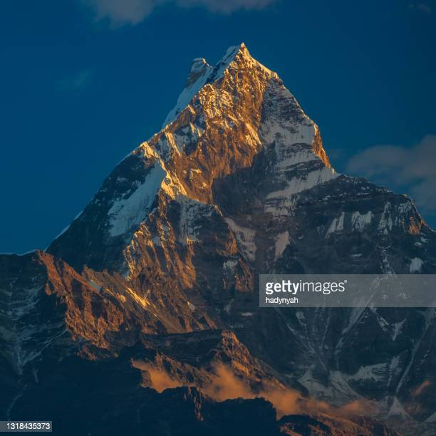 sunrise over mount machhapuchhare, annapurna range, nepal - annapurna south stock pictures, royalty-free photos & images