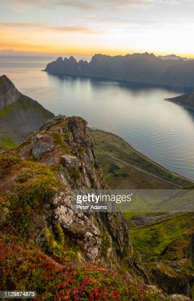 sunrise over mountains and fjord on senja island, troms county, norway - peter adams stock pictures, royalty-free photos & images