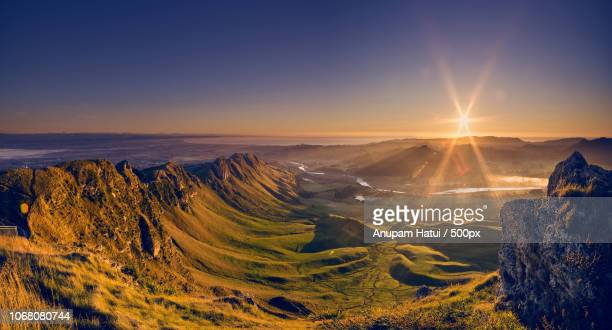sunrise over mountains - hastings stock photos and pictures