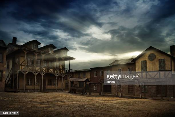 sunrise over old town - wild west stock pictures, royalty-free photos & images