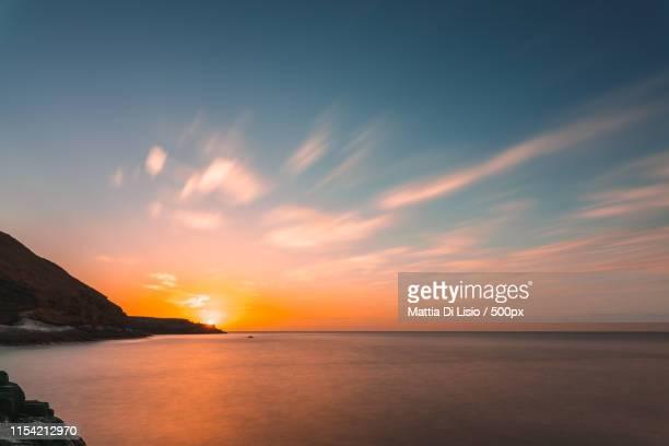 sunrise over playa amarilla - tenerife stockfoto's en -beelden
