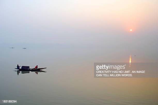 Sunrise Over River Ganges on a Misty Morning