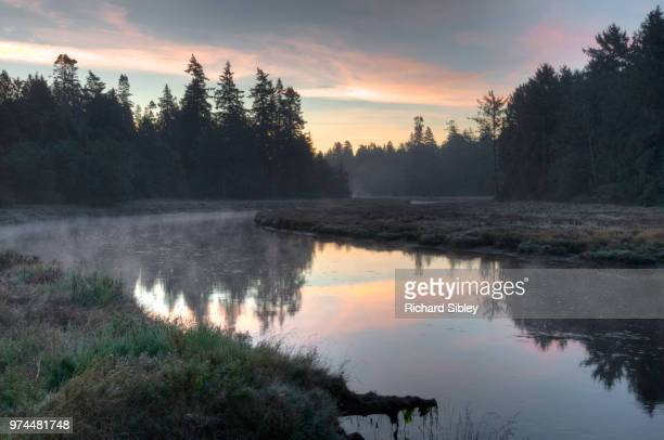 sunrise over river - sibley stock photos and pictures