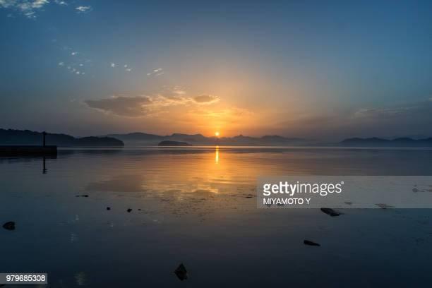 sunrise over sea, nagasaki, japan - miyamoto y ストックフォトと画像