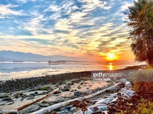 sunrise over spanish banks vancouver - atlantic ocean stock pictures, royalty-free photos & images