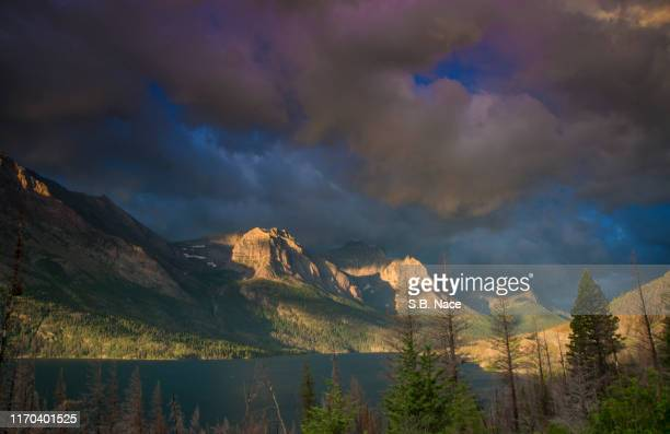 sunrise over st.mary's lake - mary lake stock photos and pictures