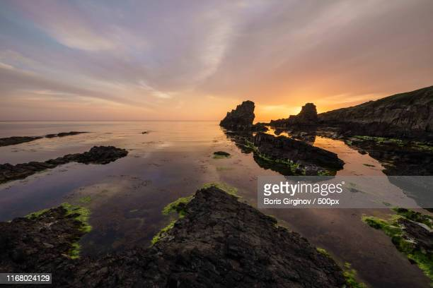 sunrise over stone ships - boris stock photos and pictures